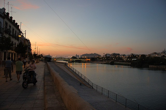 Calle Betis and the Guadalquivir at twilight